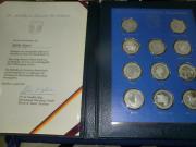 11 Silbermedaillen 275