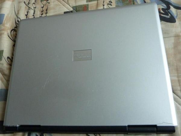Laptop Amilo M 7 405 - Berlin Tegel - Laptop Amlilo M 7 405Zuu verkaufen ein Laptop der Fa. Siemens Fujitsu Amilo M 7405 silber. DasLaptop funktioniert nicht mehr richtig. Es lässt sich kein Betriebsprogramm installieren.Die Festplatte ist ausgebaut. Eine zweite Festplatte (Ba - Berlin Tegel