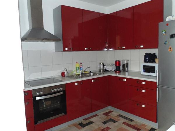Moderne Küche in Rot Hochglanz mit Elektrogeräten, L - Form in ... | {Küchen l form mit elektrogeräten 8}